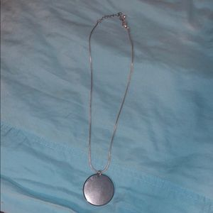Necklace with black circle accent